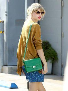Taylor Swift spotted carrying an emerald green ELIE SAAB Spring 2012 shoulder bag.