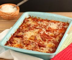 A primal, grain free, meaty, cheesy, saucy, layered pizza squash bake. Includes an easy way to roast a whole squash. Low carb and grain free.