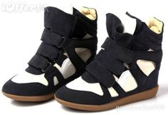 Isabel Marant Wedge Sneakers   I am definitely a high heels kinda girl, but am super fond of my Isabel Marant hidden wedge sneakers. They are comfy but do lengthen your legs. Look great with skinny jeans or a sweater dress.