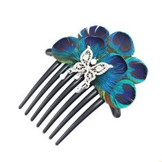 something blue?? and peacock feathers are used as a symbol for true love!....Crystalmood Peacock Feather Rhinestone French Twist Hair Comb Crystal Mood, http://www.amazon.com/dp/B005PZML98/ref=cm_sw_r_pi_dp_94Nwqb1V5QN50