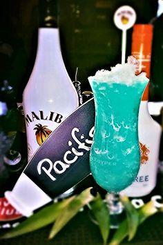 Pacific: 2cl Malibu Coconut Rum, 2 cl Peachtree, 2cl Giffard Blue Curacao syrup, 4cl orange juice, 4cl pineapple Juice