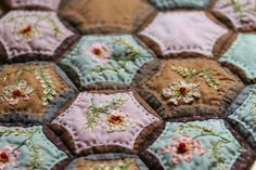 embroidery on quilt, love the colors