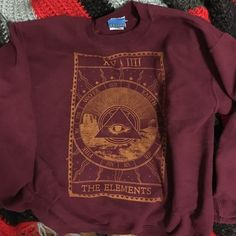 Urban Outfitters pullover sweatshirt Very cozy and soft pullover from Urban Outfitters. Hardly ever worn. Nice maroon color and graphic in perfect condition. No wear. Doing a closet clean out! :) Urban Outfitters Sweaters