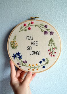 MADE TO ORDER: Please allow 3-4 weeks for your hoop to be recreated before shipping.  You Are So Loved  Add some happiness to your home with this                                                                                                                                                                                 More