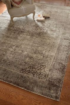 Ambrosia Rug Embracing the soft, faded patina of a cherished family heirloom, our Ambrosia rug is landscaped with scrolling vines and floral medallions in tranquil, weathered