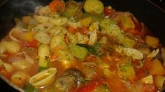 Chicken Soup for the Soul loaded with vegetables including onions garlic celery carrots potatoes butternut squash green peppers red peppers red onions cabbage cilantro and noodles and of course chicken with tomato sauce chicken cooked in olive oil first before making the soup mushrooms and squash and zuccini added too