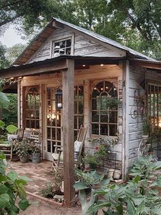 A garden shed provides a fantastic place to house your gardening tools and supplies, not to mention creating a beautiful focal point to your backyard. #country_garden_shed