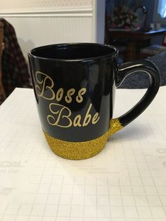 """Looking for a gift for your boss or members of your team. Look no further. This coffee mug is elegantly done with a touch of fine gold glitter and gold lettering  """"Boss Babe""""  Is the women in your life the boss of the house. This is a perfect mug for her. COme visit shop for more great gift ideas.  https://www.etsy.com/shop/craftycutterdesigns"""