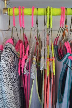 NICE & REFRESHING: Use neon trims to give your wire clothing hangers a fresh & smashing look.   DIY or ask YourHanger for the possibilities.  Source:  Neon trims in harmony at the Surf Bazaar store in Montauk. WGSN store shot