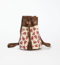 Namu bag in red. Cotton canvas material with fine leather on the bottom and top opening part. Waterbased ink. Hand embroidery. Cotton yarn.  http://www.zocko.com/z/JKRsZ