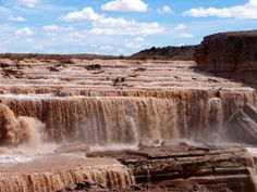 After cascading over a wide spillway of basalt, the water begins its final plunge over the volcanic wall, forming Arizona's Grand Falls. The vertical drop of the Grand Falls is 185 feet (56 m) — greater than the drop of Niagara Falls.