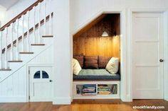 Home Interior Design — Cozy Reading Nook under Stairs in Clean, White. Space Under Stairs, Cupboard Under The Stairs, Under Staircase Ideas, Under Stairs Playhouse, Book Corners, Reading Corners, Nook And Cranny, Cozy Nook, Stair Storage