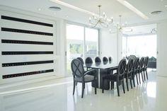 Sleek wine storage that creates a minimalist focal point by Vanguarda Architects