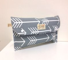 Diaper clutch nappy wallet bag. 'White Arrows' on grey cotton. Fantastic baby shower gift. by handmadebymegs on Etsy https://www.etsy.com/listing/195236984/diaper-clutch-nappy-wallet-bag-white
