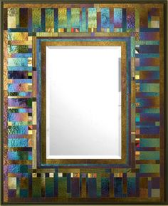 Hand cut glass piece are precisely assembled to create exquisite glass mosaic. The iridescent glass changes color with lighting conditions. Some of the glass pieces are drawn on by the artist with a kiln fired vitreous paint to establish the character of each unique mirror frame.