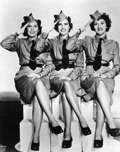 The Andrews Sisters - great 1940s style fashion and music .. these are costumes, they were not in the military