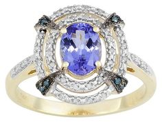 1.08ct Oval Tanzanite With .11ctw Round White And .04ctw Round Blue Diamond Accent 10k Gold Ring
