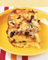 Sausage Breakfast Casserole with Sun-Dried Tomatoes | Martha Stewart Living - You can prepare the sausage breakfast casserole up to a day ahead and let the bread soak overnight in the refrigerator. (If it is refrigerated overnight, it may need to cook a few minutes longer.)