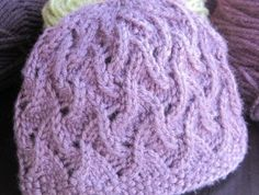 I don't knit, but I think this pattern is so cute - especially in a soft pink or lavendar for a baby girl. Maybe my mom could do it :)