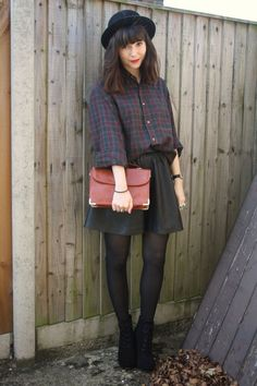 Dark tone plaid shirt with leather skirt and black pantyhose
