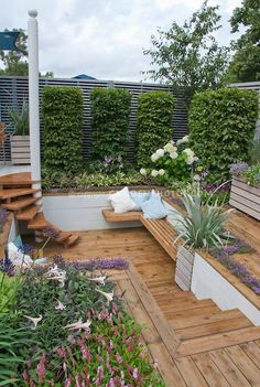 >> Great Sunken deck and steps stairs with hydrangeas in bloom, lilies, thyme herbs, Pers...