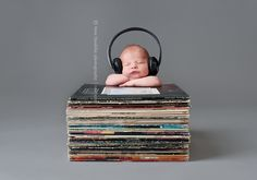 Rock and Roll Newborn. A newborn pose with old records.  by bree franklin photography