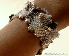 $119.99. A mix of sterling silver seed beads and glass seed beads in freeform peyote, for sale https://www.etsy.com/listing/168199257/silvertones-freeform-peyote-bracelet?