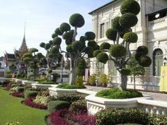 whimsical sculpted trees at the Grand Palace Garden, Bangkok, Thailand.