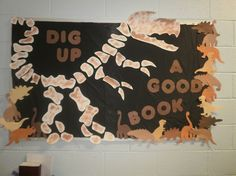 dig up a good book display T Rex dinosaur bulletin board