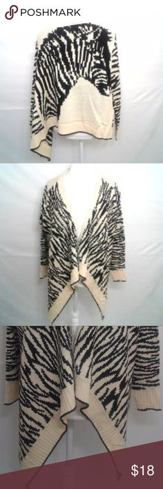 """Zebra Knitted Pancho One Size fits all New with tags, no flaws-Cream and black. Measures as 22"""" Arm pit to arm pit, 24"""" Length 36"""" Sleeve All measurements are taken lying flat. No rips stains tears or flaws, Colors may vary from screen to screen. (Bin-E) 365 Sweaters Shrugs & Ponchos"""