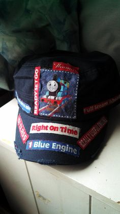 "Thomas the tank engine and friends boys cadet hat in navy famous sayings ""Really useful engine"". $15.99, via Etsy."