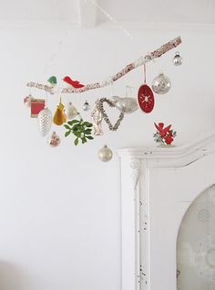 Note to self: Great idea for themed hangings...ie theme coastal with shells, sea glass, sea colored Christmas tree balls, etc. hanging from a driftwood branch. Pocket Full of Whimsy: Merry Bobble Hanging Thing | DIY-ish