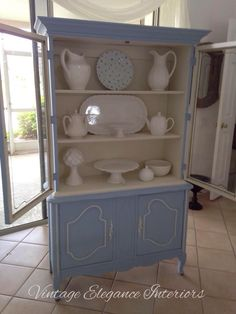 French Provincial China cabinet painted in Annie Sloan Louis Blue with Old White trim and inside the cabinet by Vintage Elegance Interiors. Annie Sloan Chalk Paint Colors, Annie Sloan Painted Furniture, Annie Sloan Paints, Chalk Paint Furniture, Painted China Cabinets, Painted Coffee Tables, White Trim, Storage, French Provincial