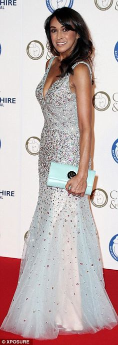Lovely look: She accessorised with a mint green clutch bag...