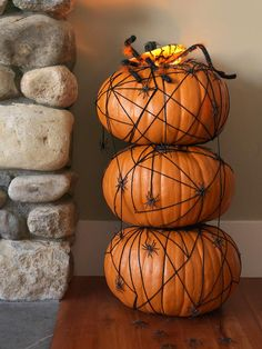 Spider's Nest Pumpkin Topiary >> http://www.diynetwork.com/decorating/4-ways-to-make-a-pumpkin-topiary/pictures/index.html?soc=pinterest