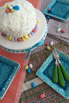 This Easter serve up a coconut cake that mimics a bunny on a white pedestal cake plate from HomeGoods. Pair it up with Spring inspired colorful linens, coral table runner and embossed turquoise square ceramic plates to add even more color to your table. Sponsored Happy By Design Post.