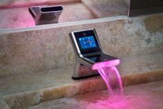 touch screen faucet. You can set the color, exact temperature and play music in your bathtub.   Neat!