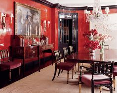 Dramatic red walls with glossy black trim.
