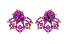 Romance collection studs and earring jackets in 18k gold with 4.8 cts. t.w. rubies; $5,280; Carla Amorim, Chicago; 312-305-6476; carlaamorim.com