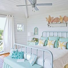 Soothing Beachy Bedrooms | Reclaimed Flair | Get the same lazy summer days look by scouring flea markets for vintage finds such as mirrors, old windows, and cabinet doors to lend a sense of history to the room. A new coat of seafoam-green paint freshens furnishings and enhances the coastal vibe.