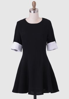 The perfect canvas for statement accessories, this little black dress features a fit-and-flared silhouette designed with princess seams for a flattering fit. Contrasted with white cuffed sleeves ...