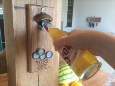 Fantastic solid oak bottle opener with magnetic lid collector - finally an easy gift for men! Available from www.holderandhook.co.uk