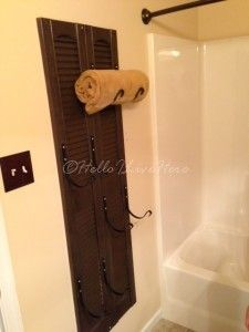 DIY Shutter Towel Rack :: Hometalk- The shutter is a little too country for me, but I love the hooks for wall-hanging towels.