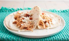 These slow cooker 5 ingredient chicken tacos are such an easy family dinner and will be sure to become a favorite meal (they're my favorite taco recipe!)