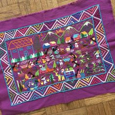 These hand-embroidered story-cloth textiles are made by the women of Tzintzuntzan, Michoacán. Story cloths are a folk art tradition in many countries around the world. In the Twin Cities we are familiar with the Hmong story cloths from the highlands of Laos. These, from Mexico, describe daily activities of rural
