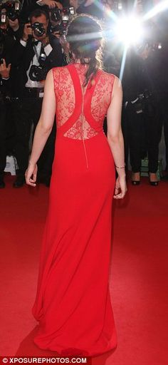Daring dress: Not only was the gown low cut but the back of the dress had slithers of lace paneling