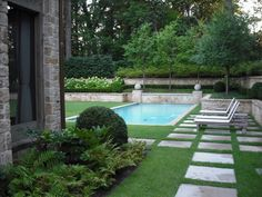 hydrangea draws your eye back to stone wall and the pavers look great in the grass,  peaceful
