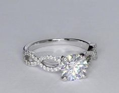 This is QUITE lovely!!! Infinity Twist Micropave Diamond Engagement Ring in 14K White Gold | Blue Nile