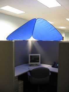 CubeShield™ blocks out bothersome overhead lights while providing added personalization and privacy to office cubicles & Cubicle Canopy...this look familiar to any of my work buddies ...