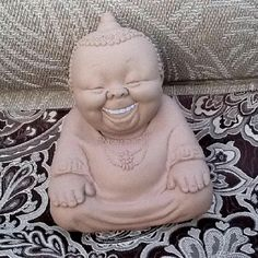 Rose O'Neill created this laughing Buddah. She also was famous for the Cupie doll.